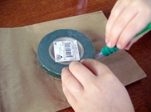 Using something round (the florist tape roll works!) or free hand, draw circles on the bag.