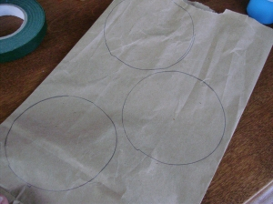 Stagger your circles as pictured, drawing three on each bag.