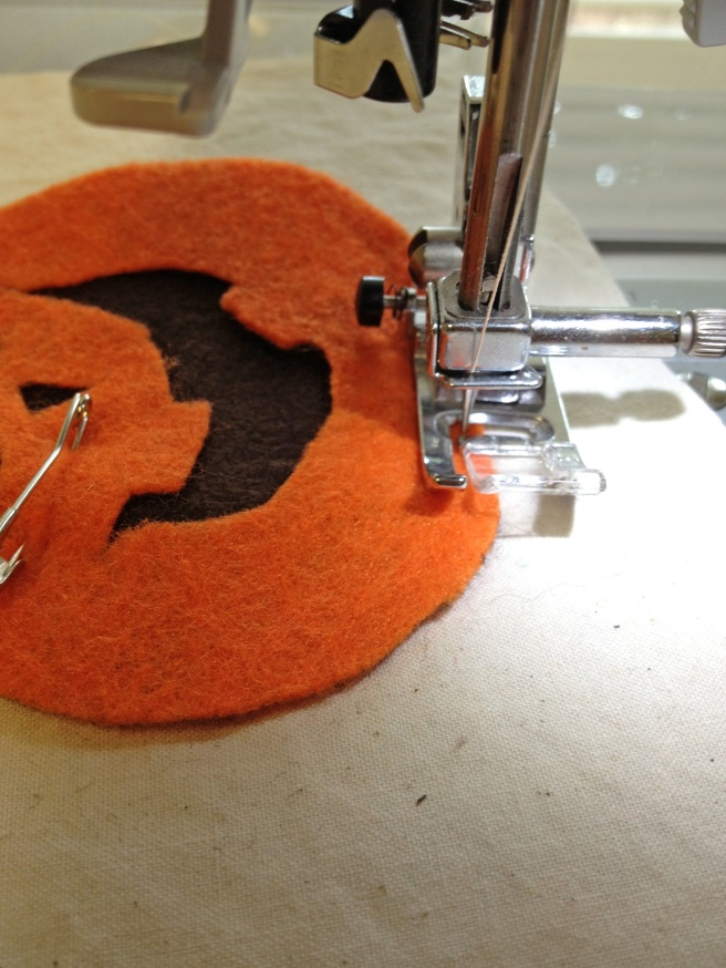 Sew around perimeter of ORANGE pumpkins, staying close to the edge--about an eighth of an inch.