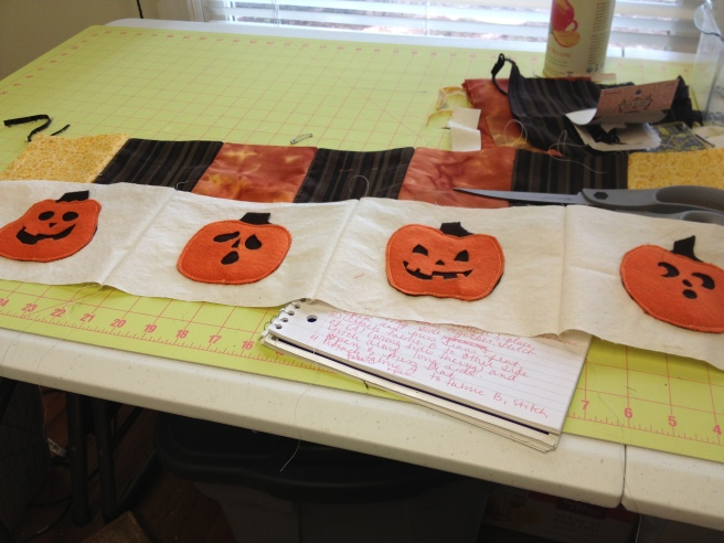 "Sew the finished pumpkin rectangles together, right sides facing in, along the 5.5"" edges. (Shown finished here.)"
